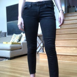 Black jeans with raw hems